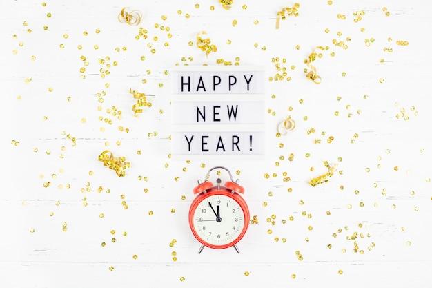 Nieuwjaar samenstelling wekker gouden confetti
