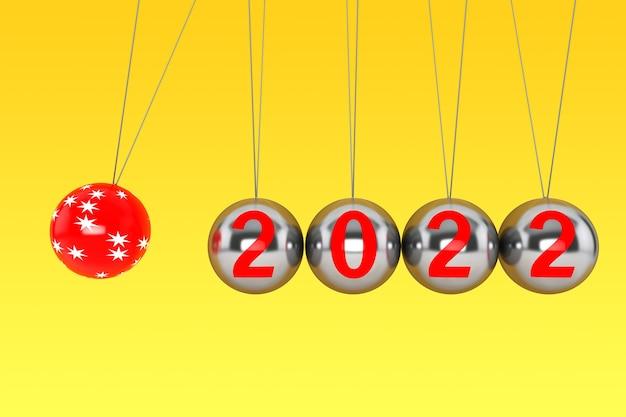 Nieuwjaarsconcept. bollen van newton met 2022 teken op een gele achtergrond. 3d-rendering
