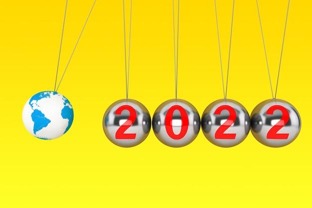 Nieuwjaarsconcept. bollen van newton met globe earth en 2022 ondertekenen op een gele achtergrond. 3d-rendering