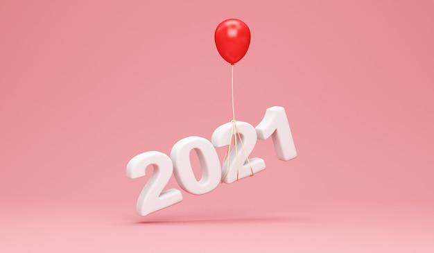 Nieuwjaarssymbool 2021 met rode ballon op roze studio
