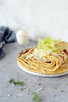 Noorse aardappelpannenkoekjes met kaas en groenten