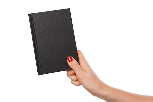 Notebook in de hand. geïsoleerd op wit.