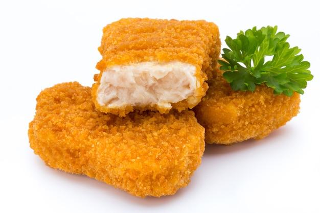 Nugget chiken op de witte achtergrond.