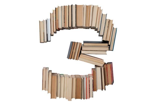 Nummer 3 gemaakt van boeken geïsoleerd op wit