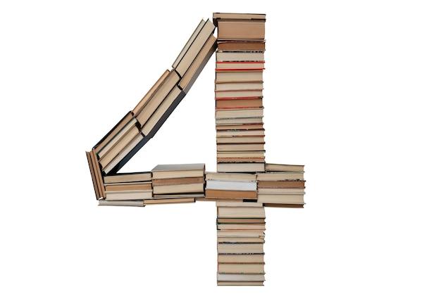 Nummer 4 gemaakt van boeken geïsoleerd op wit