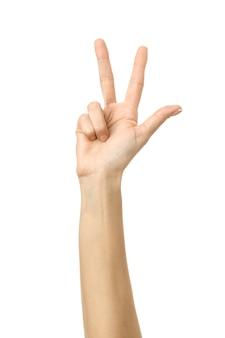 Nummer drie. vrouwenhand gesturing geïsoleerd op wit