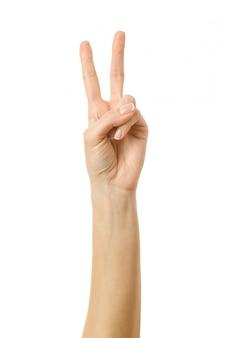 Nummer twee. vrouwenhand gesturing geïsoleerd op wit