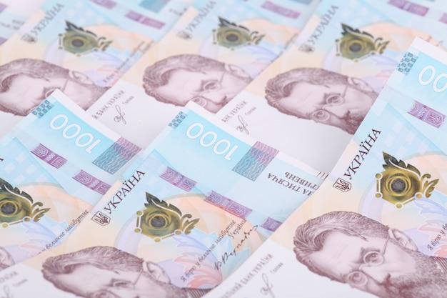 Oekraïense hryvnia, verschillende bankbiljetten van 1000 hryvnia. financiële achtergrond van oekraïense bankbiljetten. geld achtergrond.
