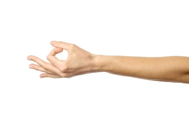 Ok teken. vrouwenhand gesturing geïsoleerd op wit