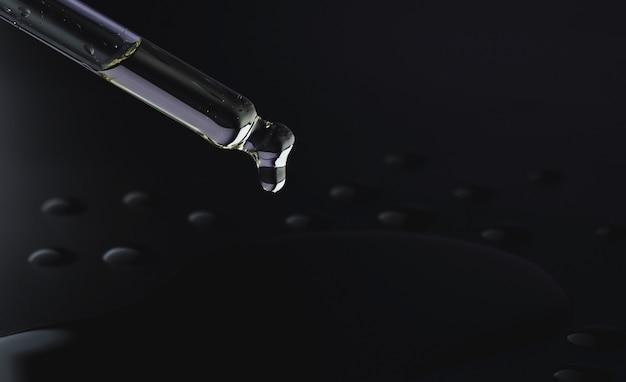 Olie druipt uit een pipet op een zwarte achtergrond