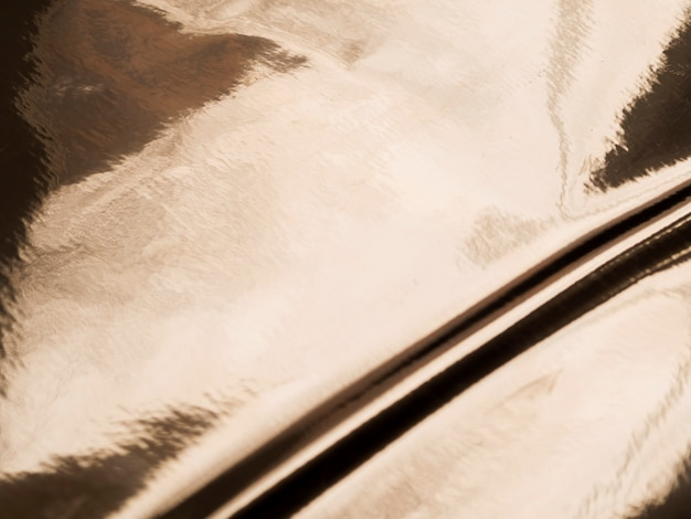 Olieachtige gouden textuurachtergrond met exemplaarruimte