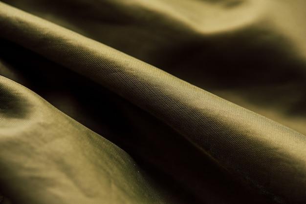 Olijfgroene stof doek textuur. groene doek achtergrondstructuur. textuur van groene stof