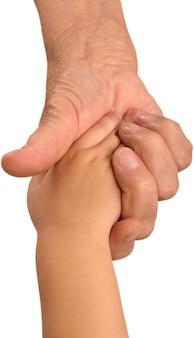 Oma en kind hand in hand op witte achtergrond