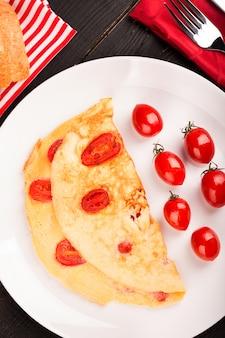 Omelet met tomaten