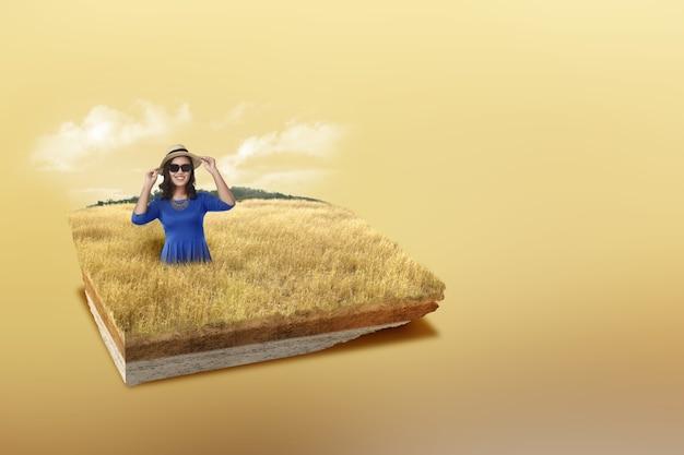 Ondergrondse bodemlaag van doorsnede aarde met aziatische vrouw met hoed en zonnebril op de savanne