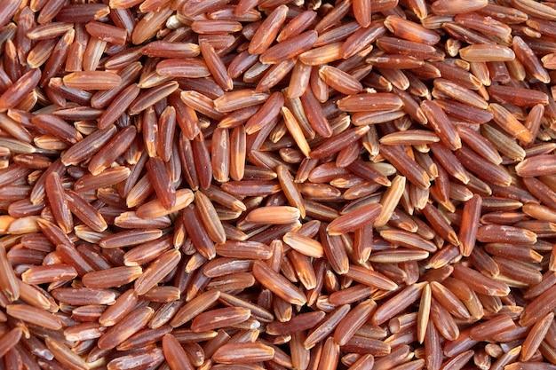 Ongekookte ongepelde rijst voor textuurachtergrond