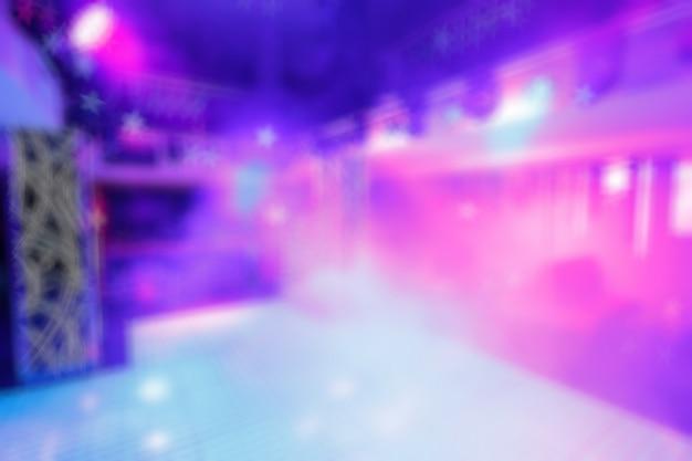 Ongericht ingang disco kleuren met schijnwerpers