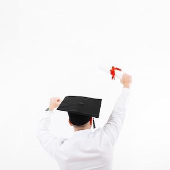 Onherkenbare man die afstuderen viert