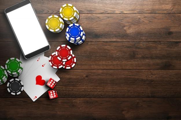 Online casino, mobiel casino, bovenaanzicht van een mobiele telefoon, chipskaarten op hout