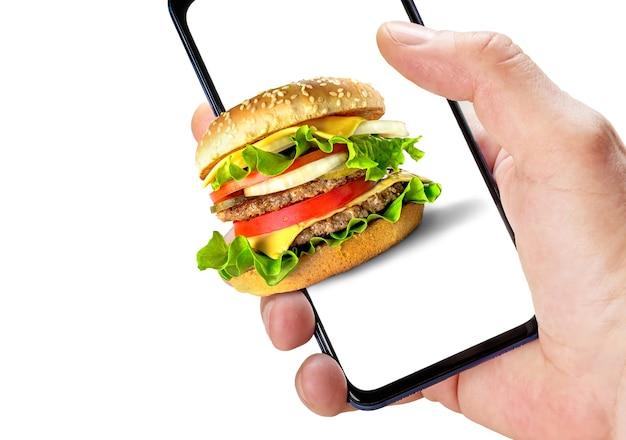 Online fastfood bestellen. hand met telefoon met hamburger op het scherm