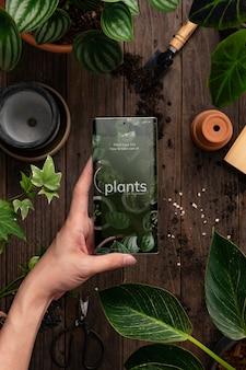 Online plantenwinkel-applicatie op het scherm van de mobiele telefoon