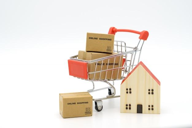 Online winkelen met een winkelwagentje en boodschappentassen bezorgservice als achtergrond winkelen