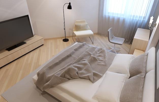 Onopgemaakt bed in een avangard-slaapkamer met witte muren