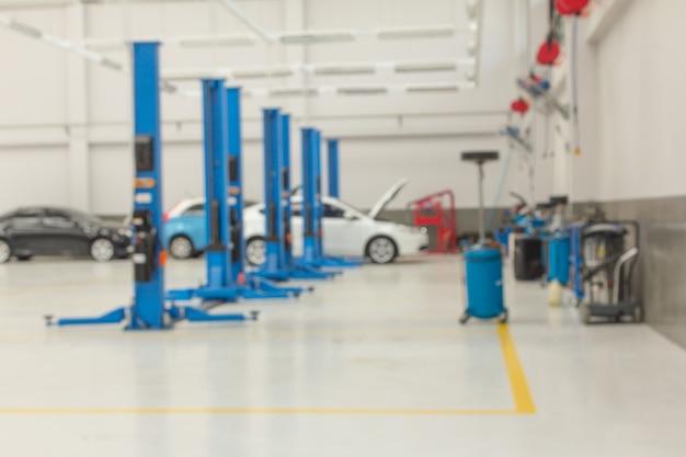 Onscherpe achtergrond van automotive service car center.