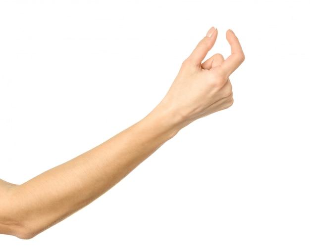 Onzichtbaar item meten. vrouwenhand gesturing geïsoleerd op wit