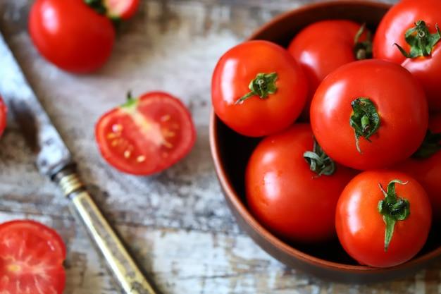 Oogst de tomaat