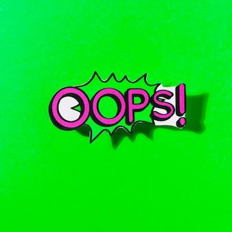 Oops! bericht komische bubble toespraak cartoon uitdrukking op groene achtergrond