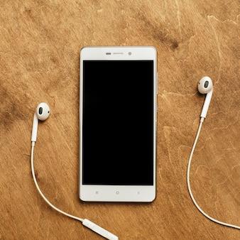 Oortelefoon met smartphone