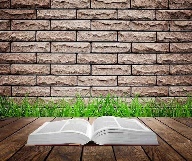 Open boek op houten plank over zonsondergangstralen de achtergrond van het onderwijsconcept