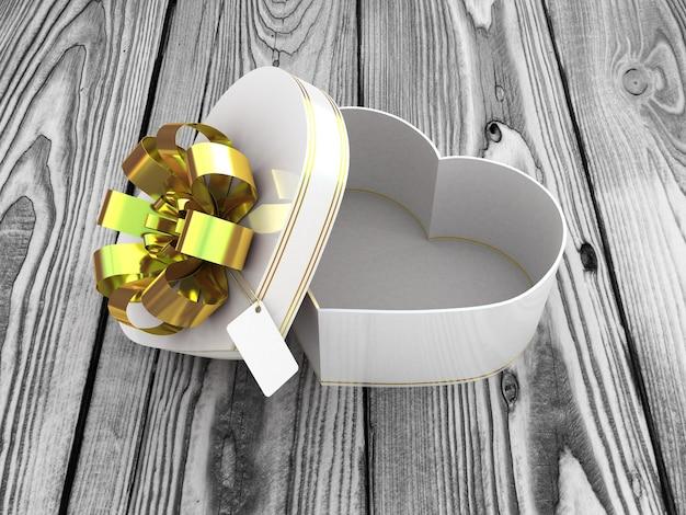 Open geschenkdoos in de vorm van hart op houten tafel