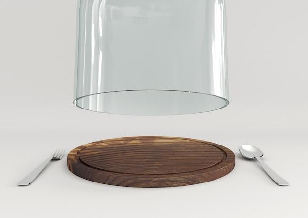 Open glazen koepel op houten plaat met lepel en vork voor uw voedselvertoning.
