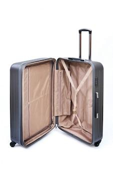 Open grijze moderne grote koffer op een wit