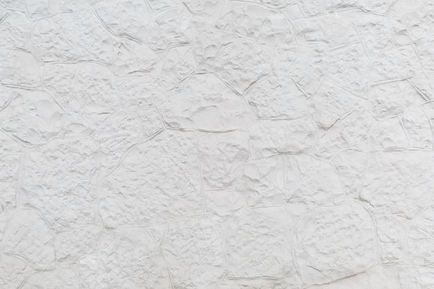 Oppervlak met wit reliëf sierpleister als achtergrond
