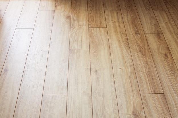 Oppervlak van verouderd laminaatbord op de vloer