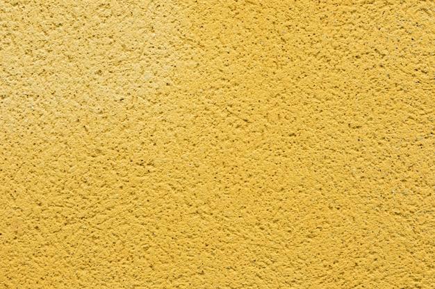 Oppervlakte achtergrond geschilderd in gele kleur