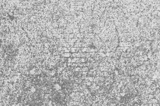 Oppervlakte van de achtergrond van de betonwegtextuur.