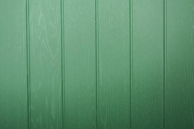 Oppervlakte van houtstructuur achtergrond met groene kleur.