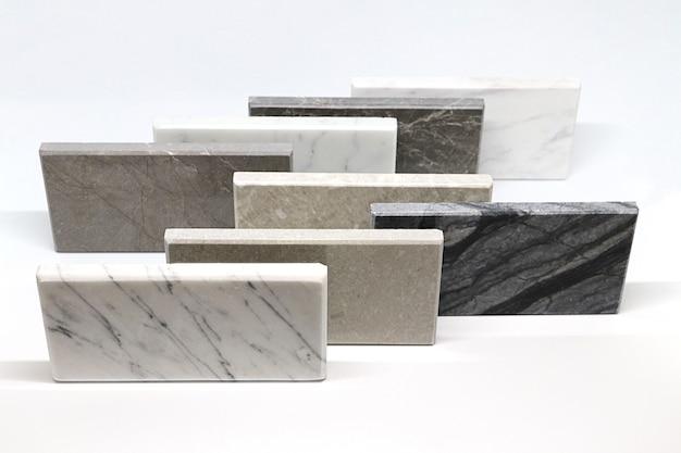 Oppervlakte van steentextuur, vooraanzicht van steen van kleurmonsters, marmer stevig materiaal voor binnenhuisarchitectuur.
