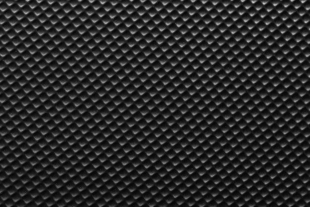 Oppervlakte van zwarte plastic of zwarte nylon textuurachtergrond.