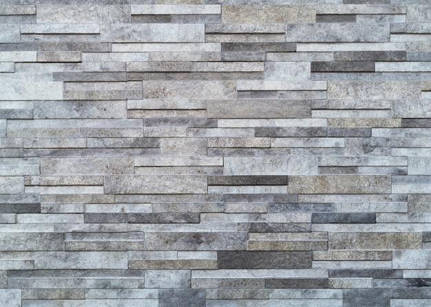Oppervlakte witte muur van grijze stenen grijswanden