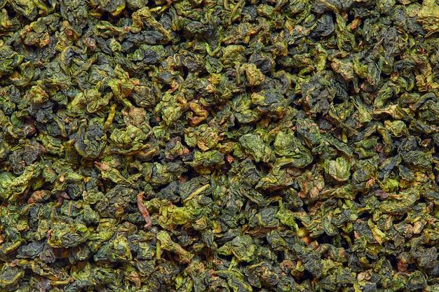 Oppervlaktestructuur van droge groene tie guan yin oolong thee