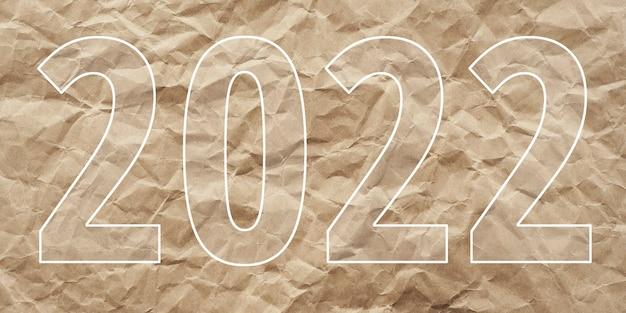 Opschrift 2022 op verfrommeld kraftpapier. concept nieuwjaar 2022.