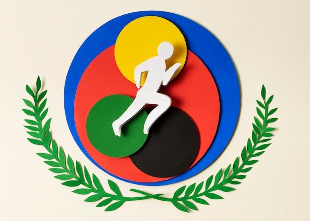 Opstelling van atleet in papierstijl op kleurrijke cirkels