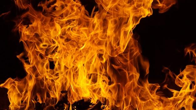 Opvlammende achtergrond van de brandvlam en geweven