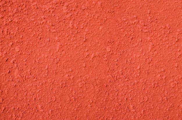 Oranje achtergrond een deel van een gipsen muur als achtergrond