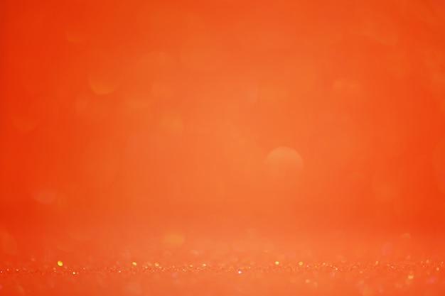 Oranje achtergrond glitter defocus en smal brandpuntsdeel. feestelijke achtergrond.